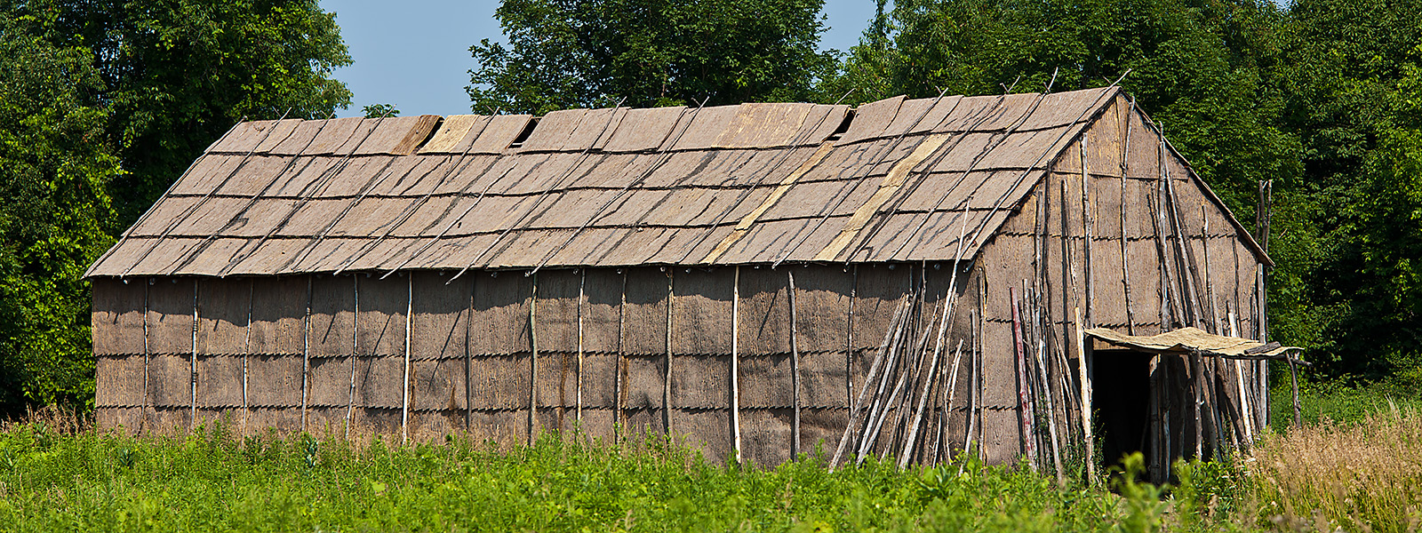 Communal long house, made from bark, Victor